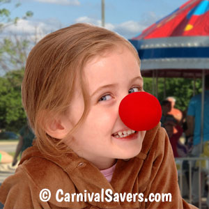 Little girl with clown nose at a carnival