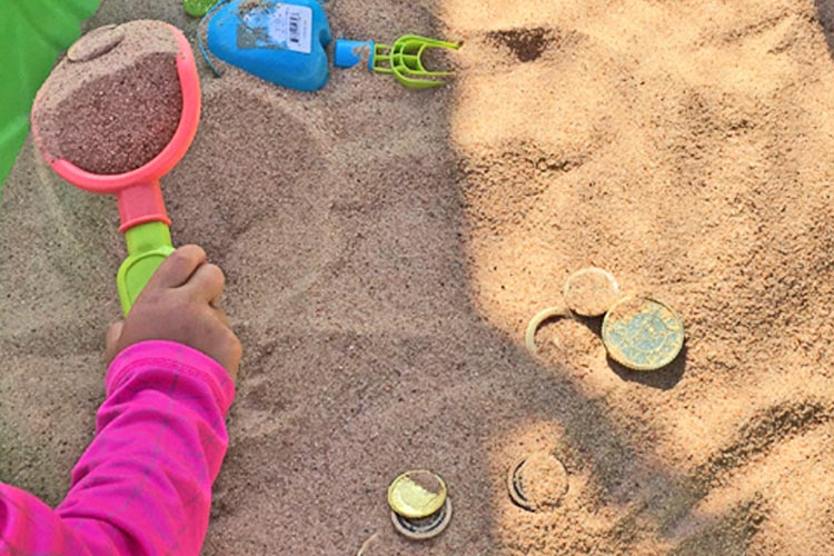 play-sand-with-toy-treasures.original.jpg